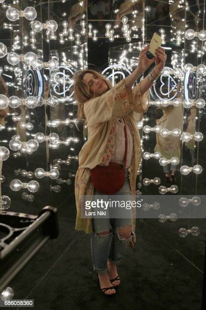 A guest poses for a selfie during Beautycon Festival NYC 2017 at Brooklyn Cruise Terminal on May 20 2017 in New York City