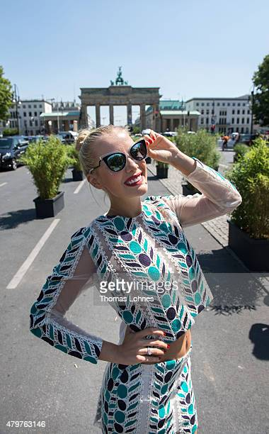 A guest poses for photographers during the MercedesBenz Fashion Week Berlin Spring/Summer 2016 at Brandenburg Gate on July 7 2015 in Berlin Germany