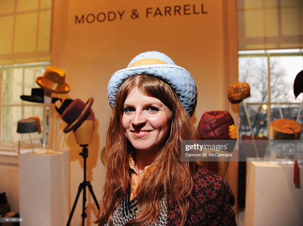 A guest poses in a hat at the Headonism installation during London Fashion Week Fall/Winter 2013/14 at Somerset House on February 15, 2013 in London, England.