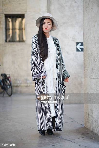A guest poses wearing a Amii total look Aimee Song poses wearing a Rochas dress and a Dior bag before the Rochas show at the Palais de Tokyo during...