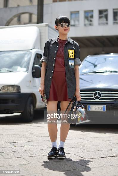 A guest poses wearing a CK dress Raf Simons shirt and Loewe bagon June 21 2015 in Milan Italy