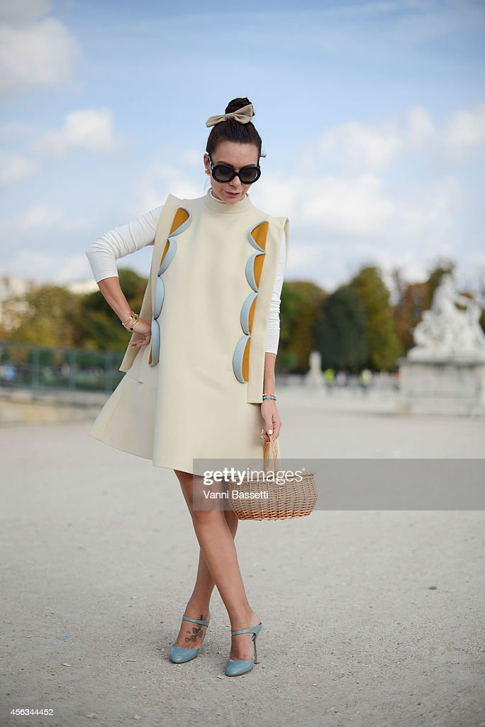 A guest poses wearing a Delpozo dress and Prada shoes on September 29 2014 in Paris France
