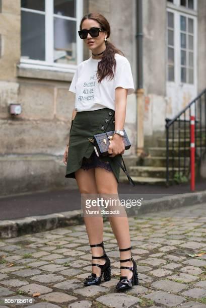 A guest poses wearing a Dior tshirt Louis Vuitton bag and Miu Miu shoes before the Rodarte show at the Cloitre Port Royal during Paris Fashion Week...