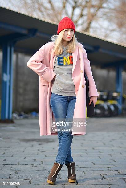 A guest poses wearing a Fendi sweatshirt and Alexander McQueen coat before the Diesel Black Gold show during the Milan Fashion Week Fall/Winter...