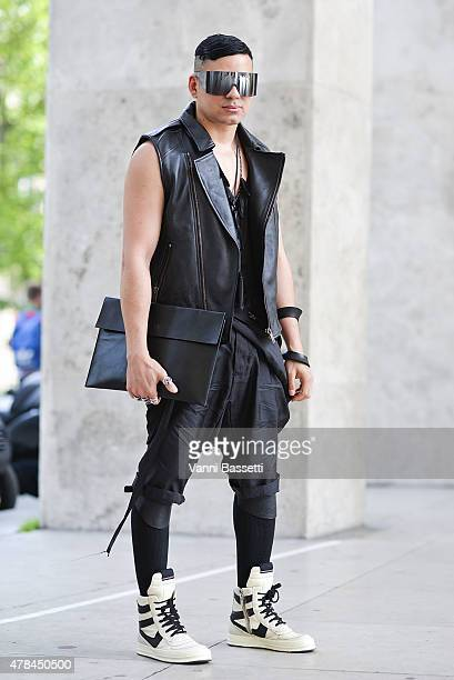 A guest poses wearing a Gareth Pugh jacket and Rick Owens shoes on June 25 2015 in Paris France