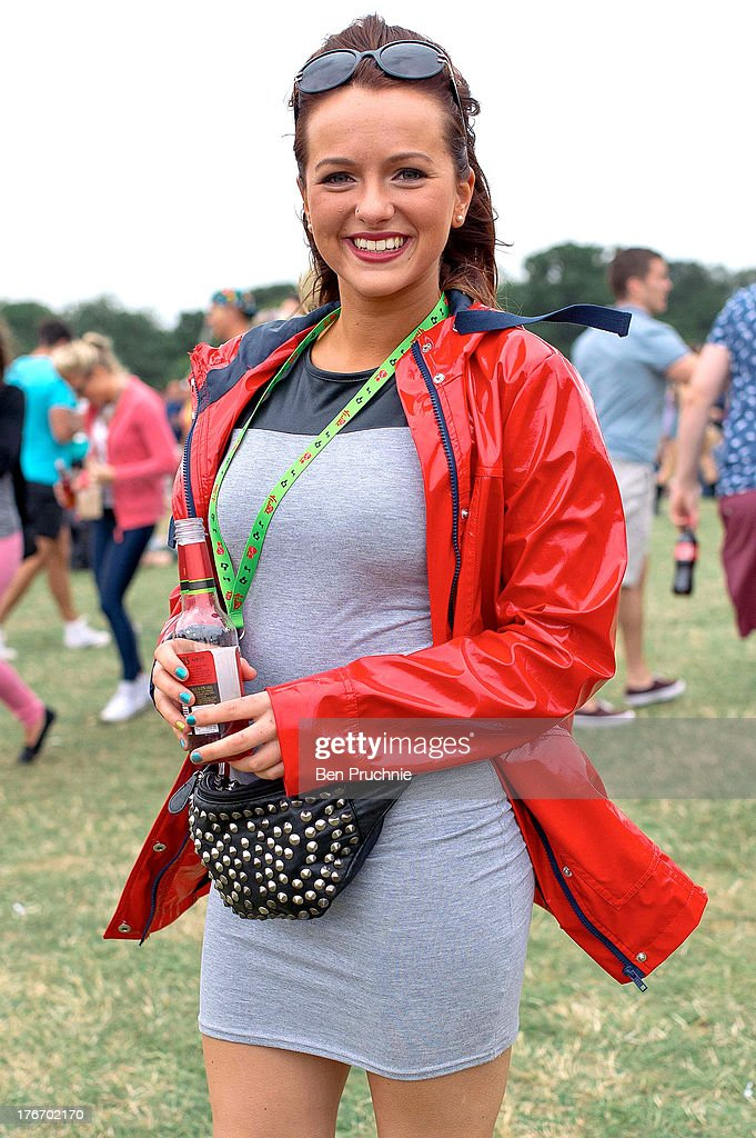 Guest poses wearing a jacket and dress from Missguided, Hunter wellies and a bum bag from New Look during V Festival at Hylands Park on August 17, 2013 in Chelmsford, England.