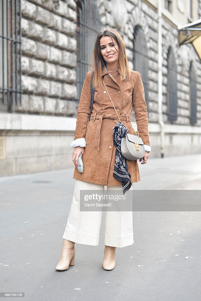 A guest poses wearing a Mango coat and Chloe bag on Day 7 of Paris Fashion Week Womenswear FW15 on March 9 2015 in Paris France