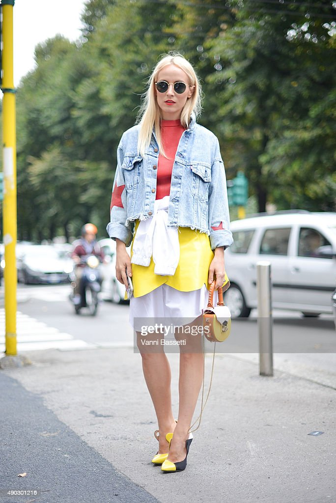A guest poses wearing a Manuki top and skirt and a Salar bag before the Marni show during the Milan Fashion Week Spring/Summer 16 on September 27...