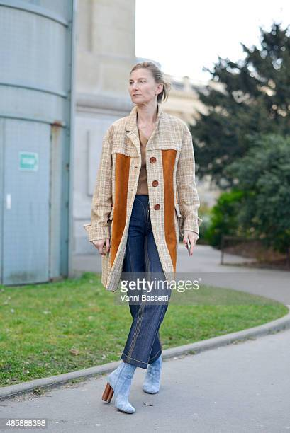 A guest poses wearing a Miu Miu coat on Day 9 of Paris Fashion Week Womenswear FW15 on March 11 2015 in Paris France