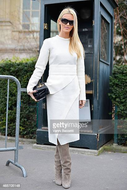 A guest poses wearing a Proenza Schouler dress on Day 7 of Paris Fashion Week Womenswear FW15 on March 9 2015 in Paris France