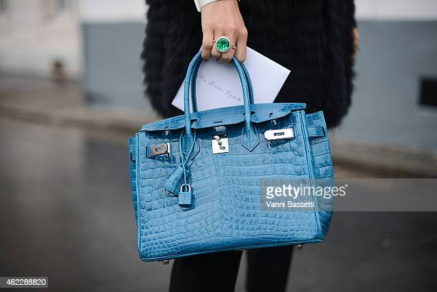 A guest poses wearing a Valentino coat and Hermes bag during day two of Paris Haute Couture Spring Summer 2015 on January 26 2015 in Paris France
