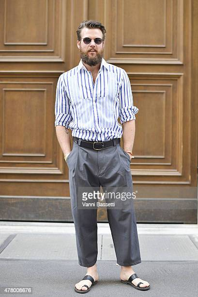 A guest poses wearing Altendorfer trousers poses on June 21 2015 in Milan Italy