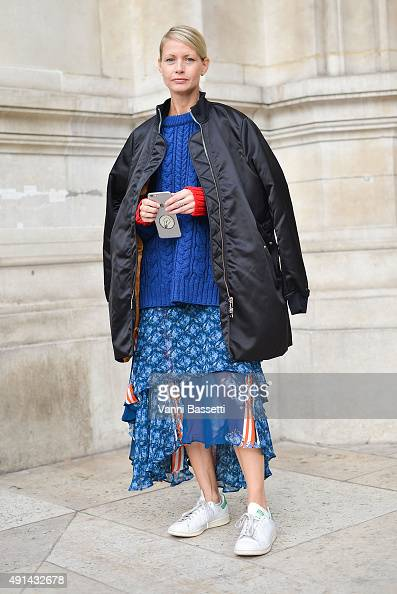 A guest poses wearing an Acne Studios bomber jacket and Preen dress after the Stella McCartney show during Paris Fashion Week SS16 on October 5 2015...