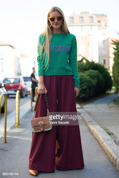 A guest poses wearing an Alberta Ferretti jumper after the Alberta Ferretti show during Milan Fashion Week Spring/Summer 2018 on September 20 2017 in...