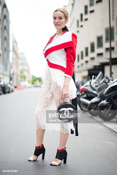 A guest poses wearing an Alexander McQueen jacket and Chanel bag before the Dior show on Avenue Montaigne during Paris Fashion Week Haute Couture FW...