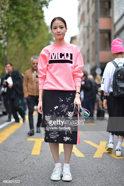 A guest poses wearing an Alexander McQueen sweatshirt before the Marni show during the Milan Fashion Week Spring/Summer 16 on September 27 2015 in...