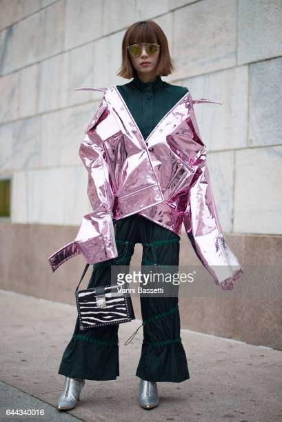 A guest poses wearing an Angel Chen coat after the Angel Chen show during Milan Fashion Week Fall/Winter 2017/18 on February 23 2017 in Milan Italy