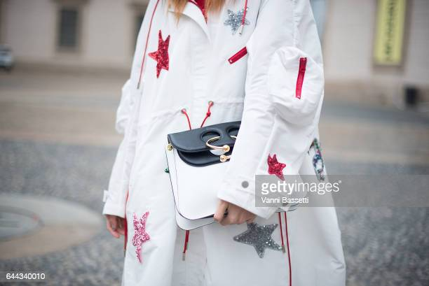 A guest poses wearing an Angel Chen coat and a JW Anderson bag after the Angel Chen show during Milan Fashion Week Fall/Winter 2017/18 on February 23...