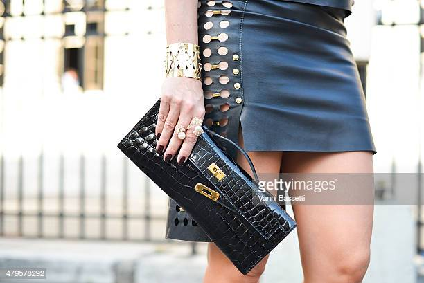 A guest poses wearing an Anthony Vaccarello dress and an Hermes bag after the Atelier Versace show at the Palais Brogniart on July 5 2015 in Paris...