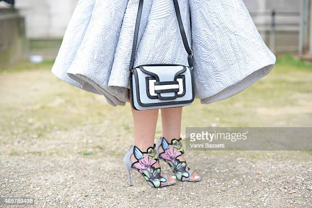 A guest poses wearing an Ashi dress and Pierre Hardy bag and shoes on Day 8 of Paris Fashion Week Womenswear FW15 on March 10 2015 in Paris France