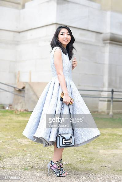 A guest poses wearing an Ashi dress and Pierre Hardy shoes and bag on Day 8 of Paris Fashion Week Womenswear FW15 on March 10 2015 in Paris France