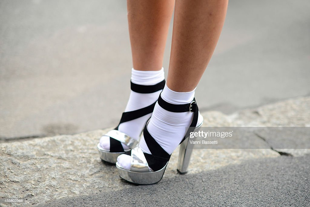 A guest poses wearing and Prada shoes on September 20 2014 in Milan Italy