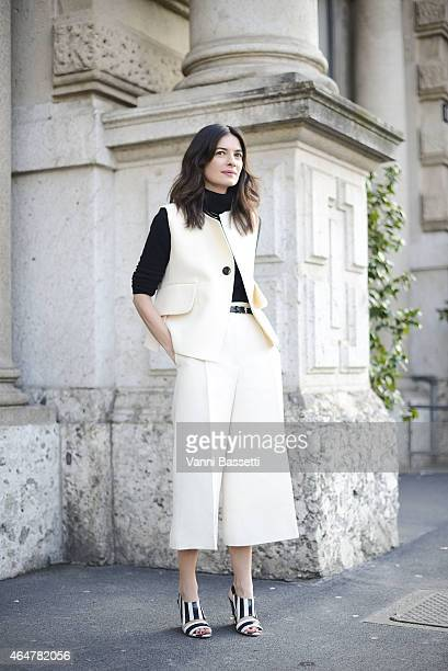 A guest poses wearing Celine before Jil Sander show on February 28 2015 in Milan Italy