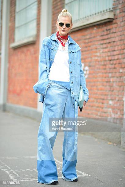 A guest poses wearing Chatty jacket and pants Celine clutch and Cos shirt before the Fendi show during the Milan Fashion Week Fall/Winter 2016/17 on...