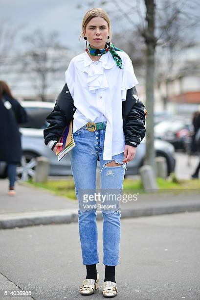 A guest poses wearing Gucci shoes and belt after the Celine show at the Tennis Club de Paris show during Paris Fashion Week FW 16/17 on March 6 2016...