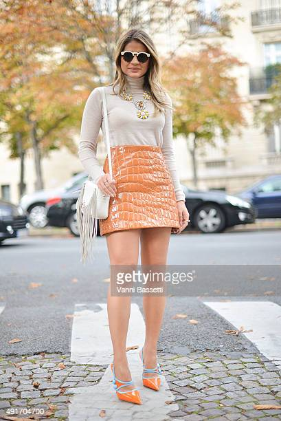 A guest poses wearing Miu Miu skirt and shoes before the Miu Miu show at the Palais de Iena during Paris Fashion Week SS16 on October 7 2015 in Paris...