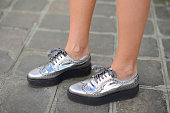 A guest poses wearing Musette shoes on September 27 2014 in Paris France