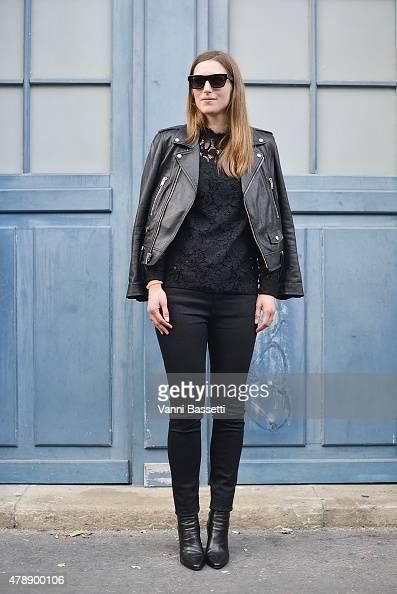 A guest poses wearing Saint Laurent before the Saint Laurent show at the Carreau du Temple on June 28 2015 in Paris France