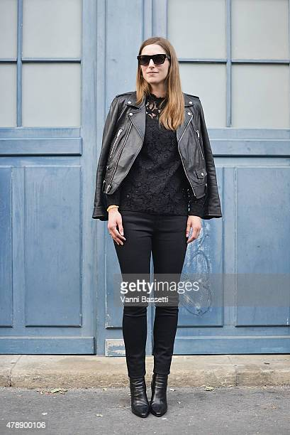 A guest poses wearing Saint Laurent before the Saint Laurent show at the Carreau du Temple on June 28 2015 in Paris France