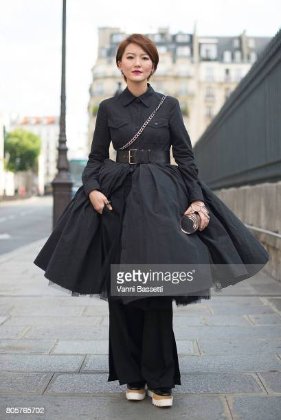 A guest poses wearing Stella McCartney shoes after the Galia Lahav show at the Lycee Henri IV during Paris Fashion Week Haute Couture FW17/18 on July...