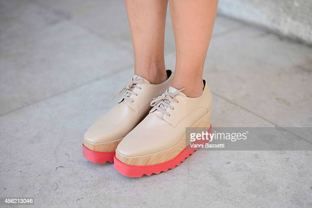 A guest poses wearing Stella McCartney shoes on September 27 2014 in Paris France