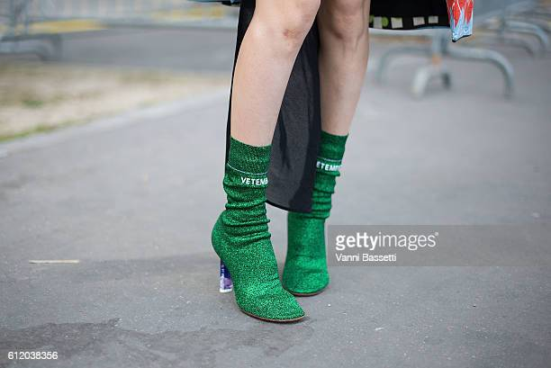 A guest poses wearing Vetements shoes after the Celine show at the Tennis Club de Paris during Paris Fashion Week Womenswear SS17 on October 2 2016...
