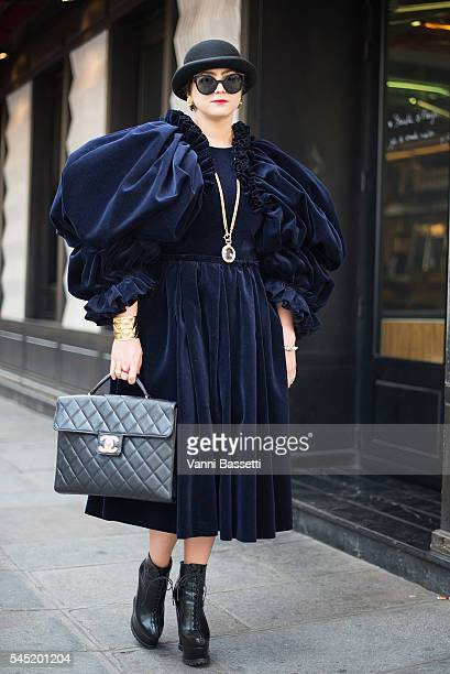 A guest poses with a Chanel bag after the Jean Paul Gaultier show during Paris Fashion Week Haute Couture FW 16/17 on July 6 2016 in Paris France