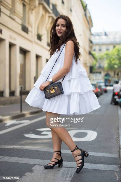 A guest poses with a Louis Vuitton bag after the Jean Paul Gaultier show during Paris Fashion Week Haute Couture FW 17/18 on July 5 2017 in Paris...