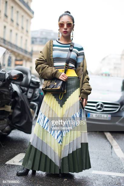 A guest poses with a Prada bag after the Vivienne Westwood show at the Hotel Intercontinental on March 4 2017 in Paris France