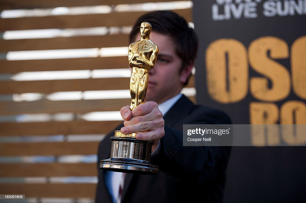A guest poses with an Oscar trophey during First-Ever Oscar Roadtrip at the Angelika Film Center on February 18, 2013 in Dallas.