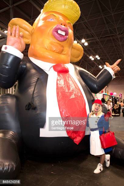 Guest poses with Trump Rat during RuPaul's DragCon NYC 2017 at The Jacob K Javits Convention Center on September 10 2017 in New York City