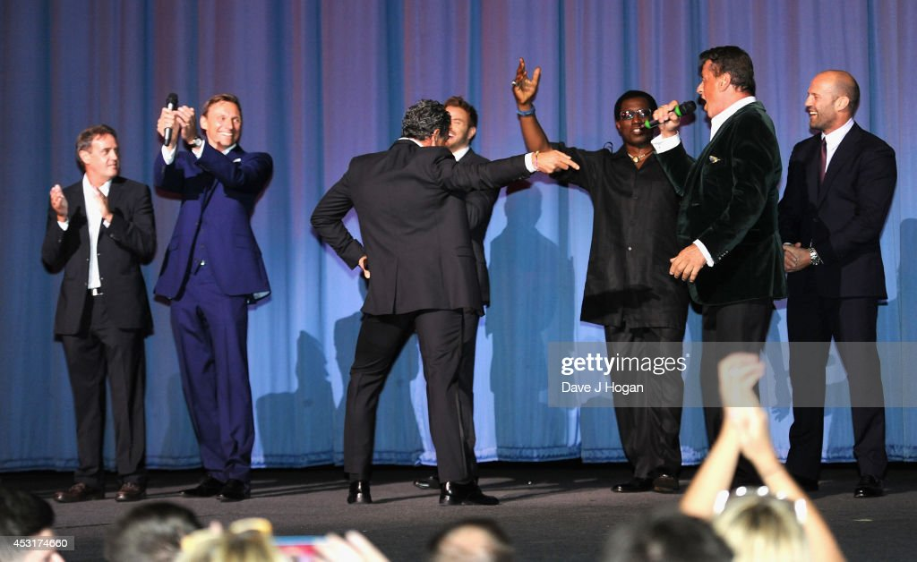 Guest, producer Zygi Kamasa, actors Antonio Banderas, Kellan Lutz, Wesley Snipes, Sylvester Stallone and Jason Statham on stage as they attend 'The Expendables 3' World Premiere at the Odeon Leicester Square on August 4, 2014 in London, England. The Expendables 3 is released on August 14, 2014.