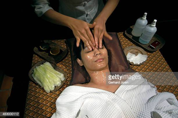 A guest receives a facial treatment with strips of cucumber a the Sikhara spa This popular spa is situated on the most famous traveller's street in...