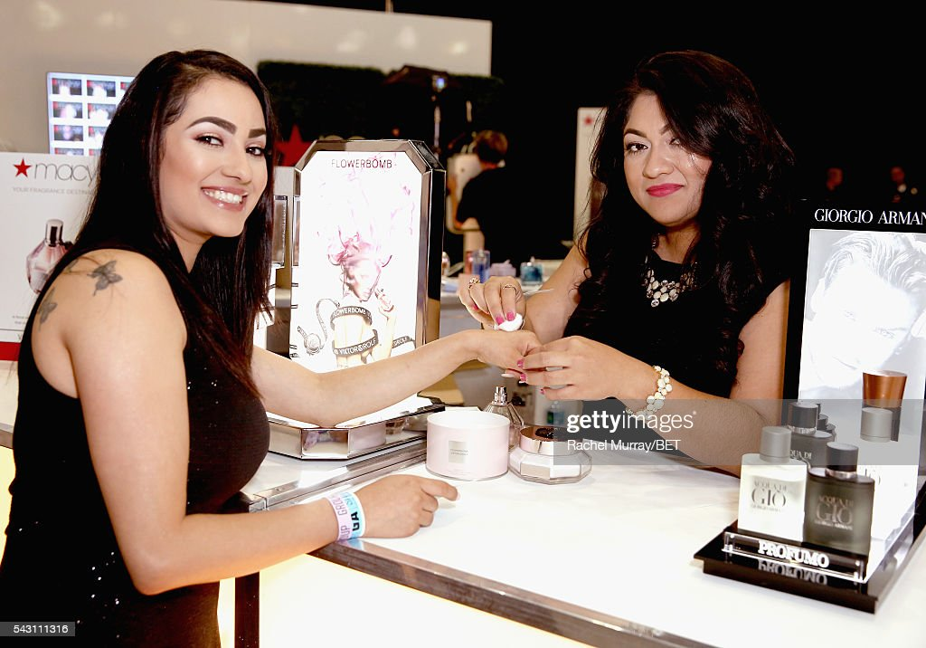 A guest receives a sample at the Macy's counter at Fashion And Beauty @BETX presented by Progressive, Covergirl, Strength of Nature, Korbel and Macy's during the 2016 BET Experience on June 25, 2016 in Los Angeles, California.
