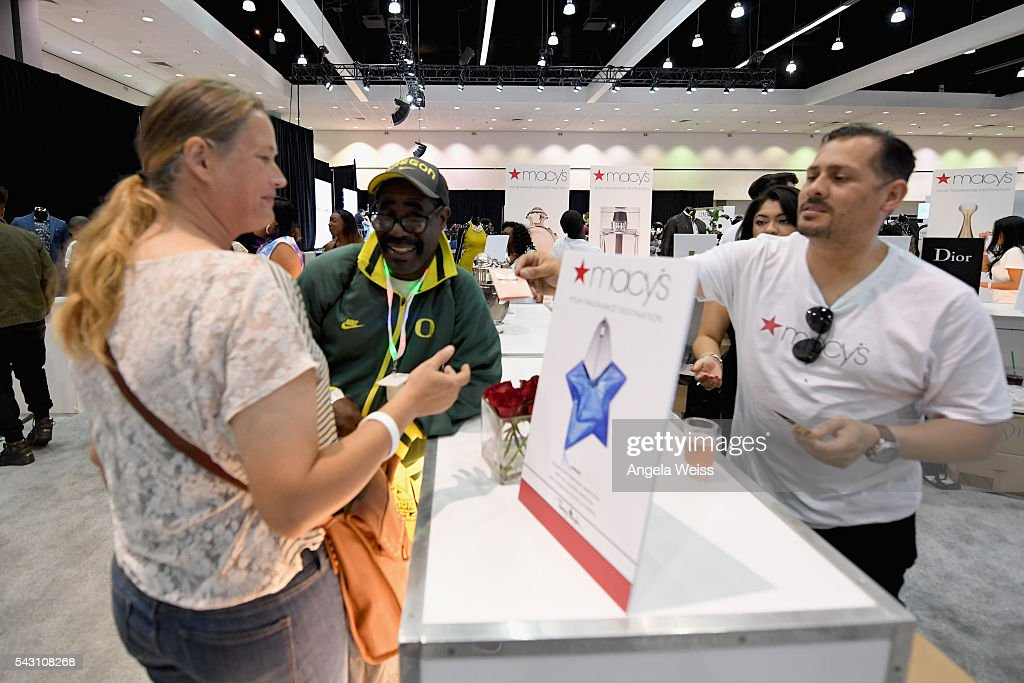 A guest receives a sample from Macy's at FAN FEST during the 2016 BET Experience on June 25, 2016 in Los Angeles, California.