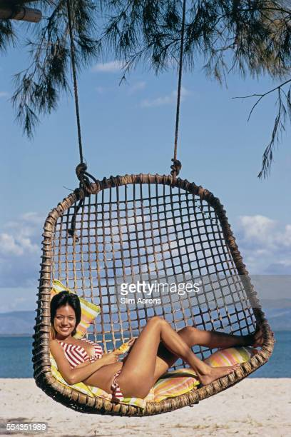 A guest relaxing on the beach of a private island owned by Philippine Airlines President Benigno Toda Jr Philippines February 1973