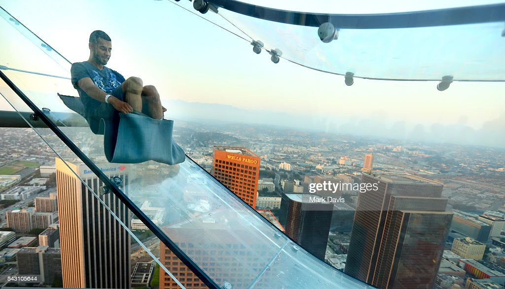 A guest rides the SkySlide during the OUE Skyspace LA grand opening block party at OUE Skyspace LA on June 25, 2016 in Los Angeles, California.
