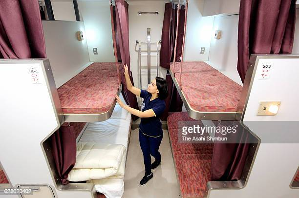 A guest room is equipped with bunk beds that were used in the Hokutosei's BClass cars at The Train Hostel Hokutosei on December 1 2016 in Tokyo Japan...