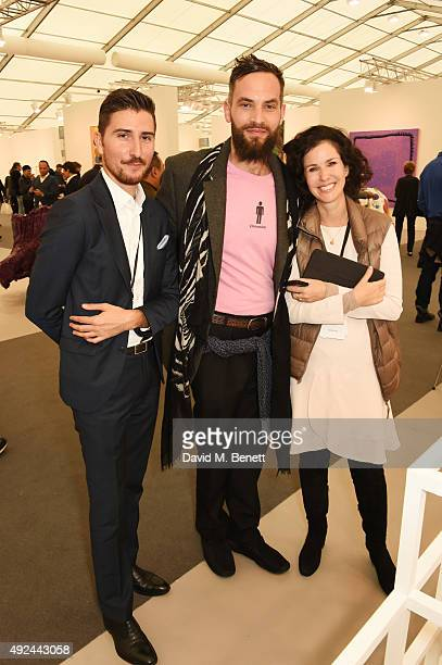 Guest Sandro Kopp and Mollie Dent Brocklehurst attend a VIP preview of the Frieze Art Fair 2015 in Regent's Park on October 13 2015 in London England