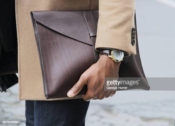 Guest seen at Industria Superstudios wearing clutch bag and watch during New York Fashion Week Men's Fall/Winter 2016 on February 1 2016 in New York...